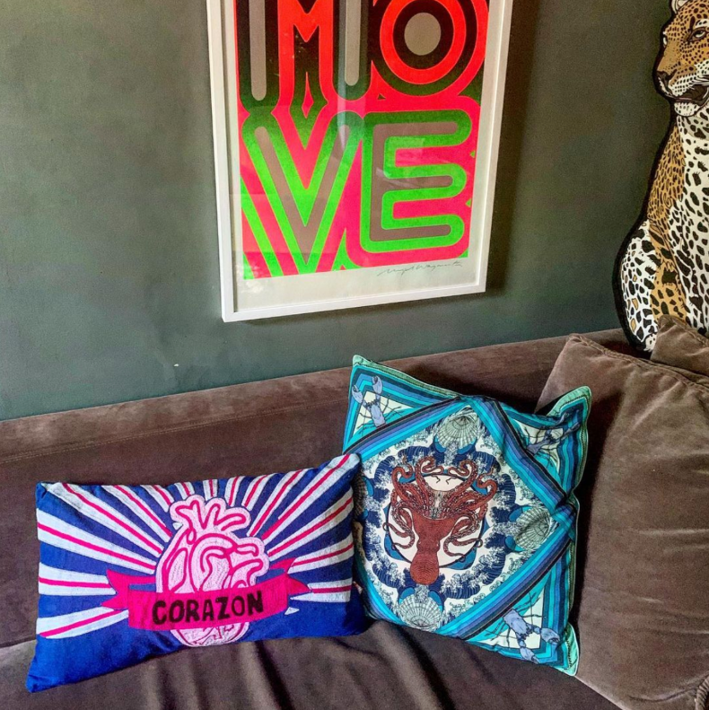 Bold bright cushions from Kitsch Kitchen and Silken Favours. Corazon heart cushion and Octopussy cushions. Funky blue cushions on sofa.